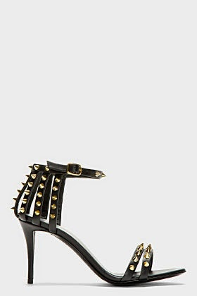 http://www.ssense.com/women/product/giuseppe_zanotti/black_leather_studded_coline_heels/97311