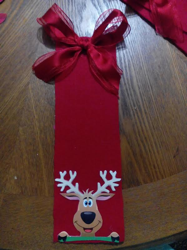 Desouvre adorno navide o para puertas hecho con fieltro for Arreglo para puertas de navidad