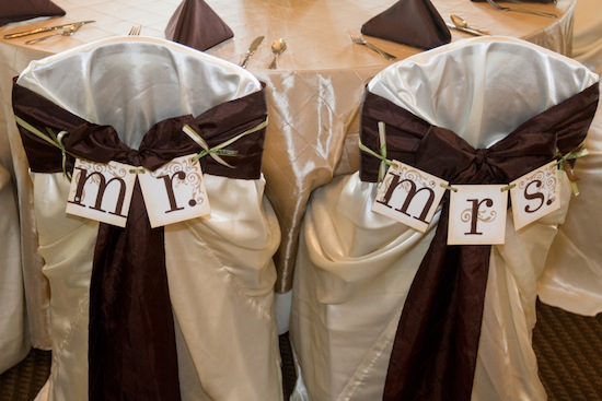 bride and groom table at reception with Mr. and Mrs. signs