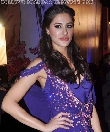 Nargis Fahkri in purple long gown exposing her cleavage hd pics