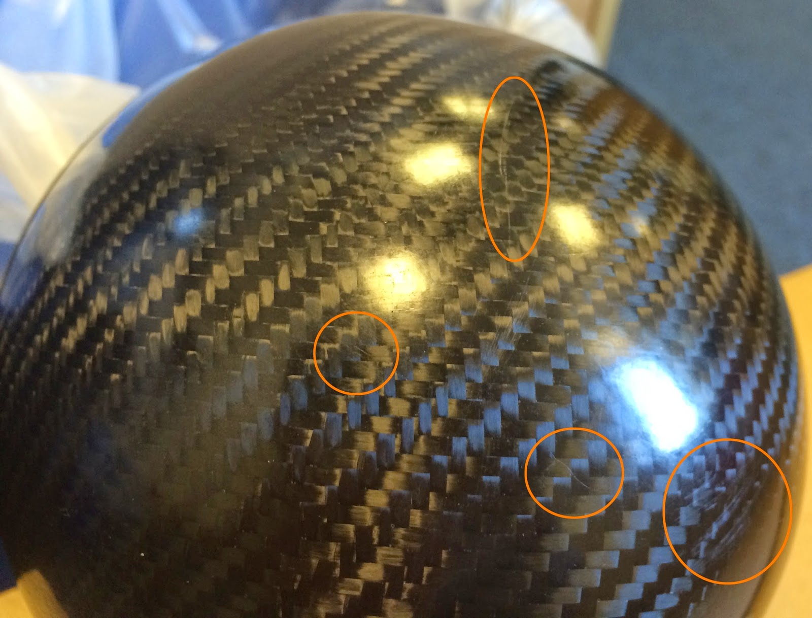 Caterham Carbon Headlight Bowls - with some of the scratches highlighted.