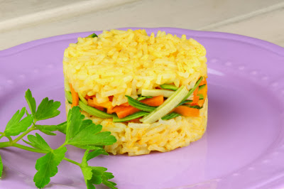 Saffron Rice Cake with carrots, squash on plate