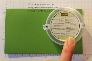Tracing a circular container to round the edges of the card base.