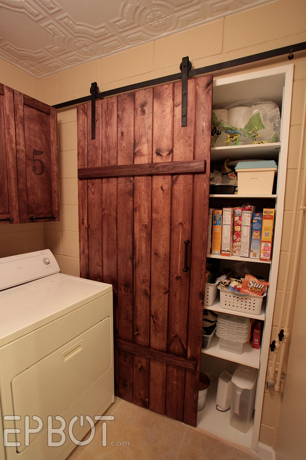 Epbot make your own sliding barn door for cheap for Sliding pantry doors