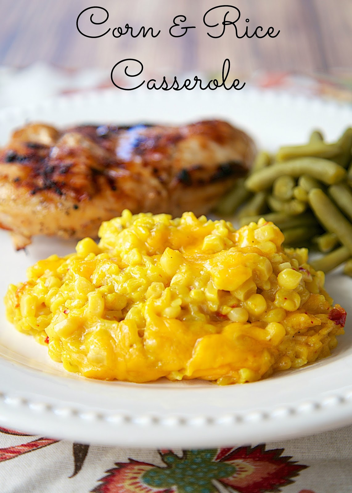 Corn and Rice Casserole - only 4 ingredients! Chicken, Rice, Soup & Cheese. It is THE BEST corn casserole I've ever eaten! Can be made ahead of time. Quick side dish recipe!