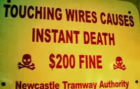 Touching-wires-causes-instant-death-$200-fine-sign