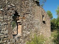 Paret del cantó nord de la masia de L'Olleret