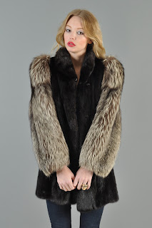 Vintage 1980's black mink coat with brown fluffy fox fur contrasting sleeves.