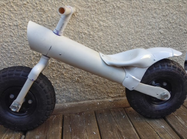 Upcycle us pvc pipes upcycled into a balance bike for Pvc pipe art ideas