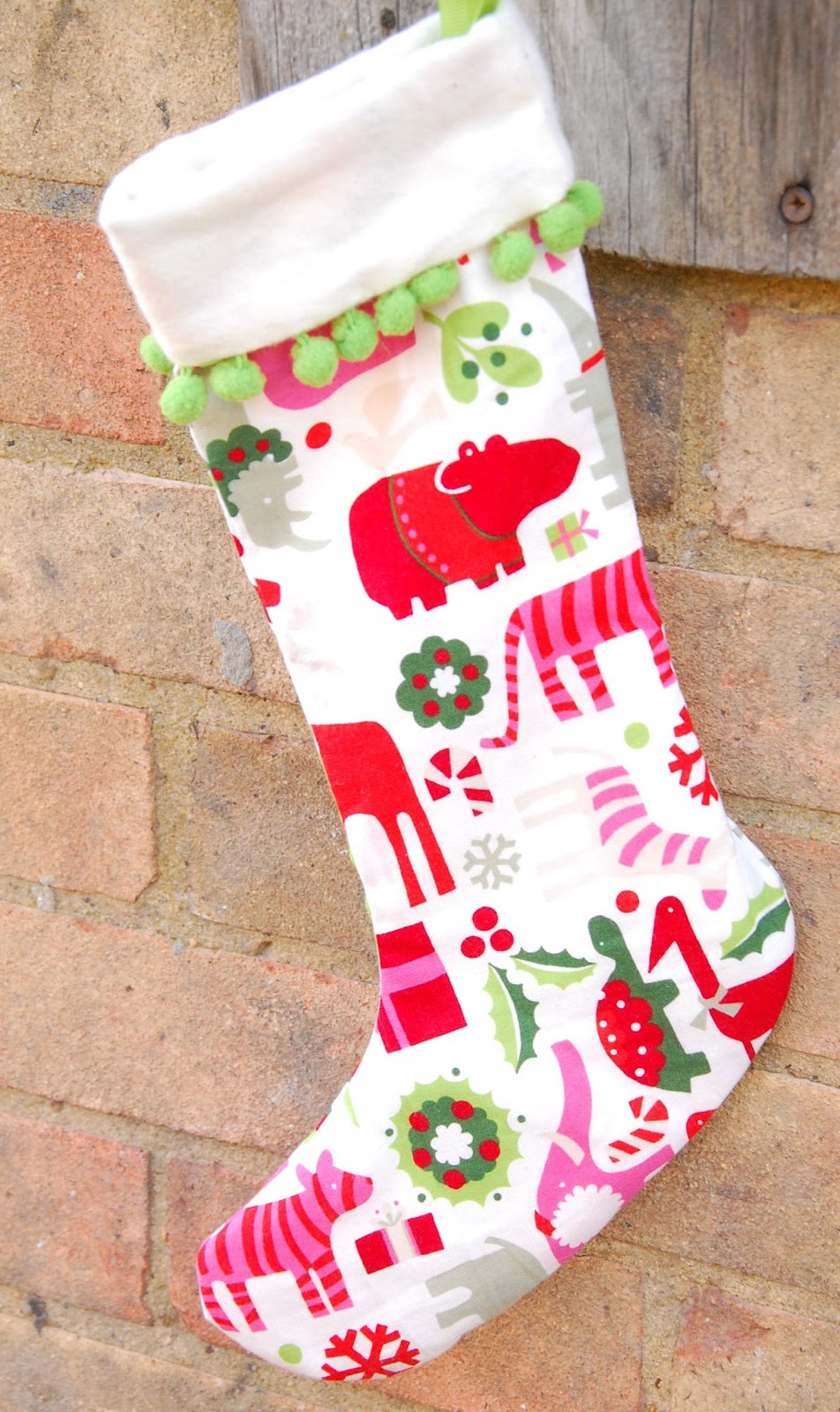 Assemble the Stocking. 1. Layer one stocking shape and one stocking lining shape with right sides (printed sides) together. Pin the top of the layered stockings together. 2. Sew the top of the stocking shapes using a 1/4