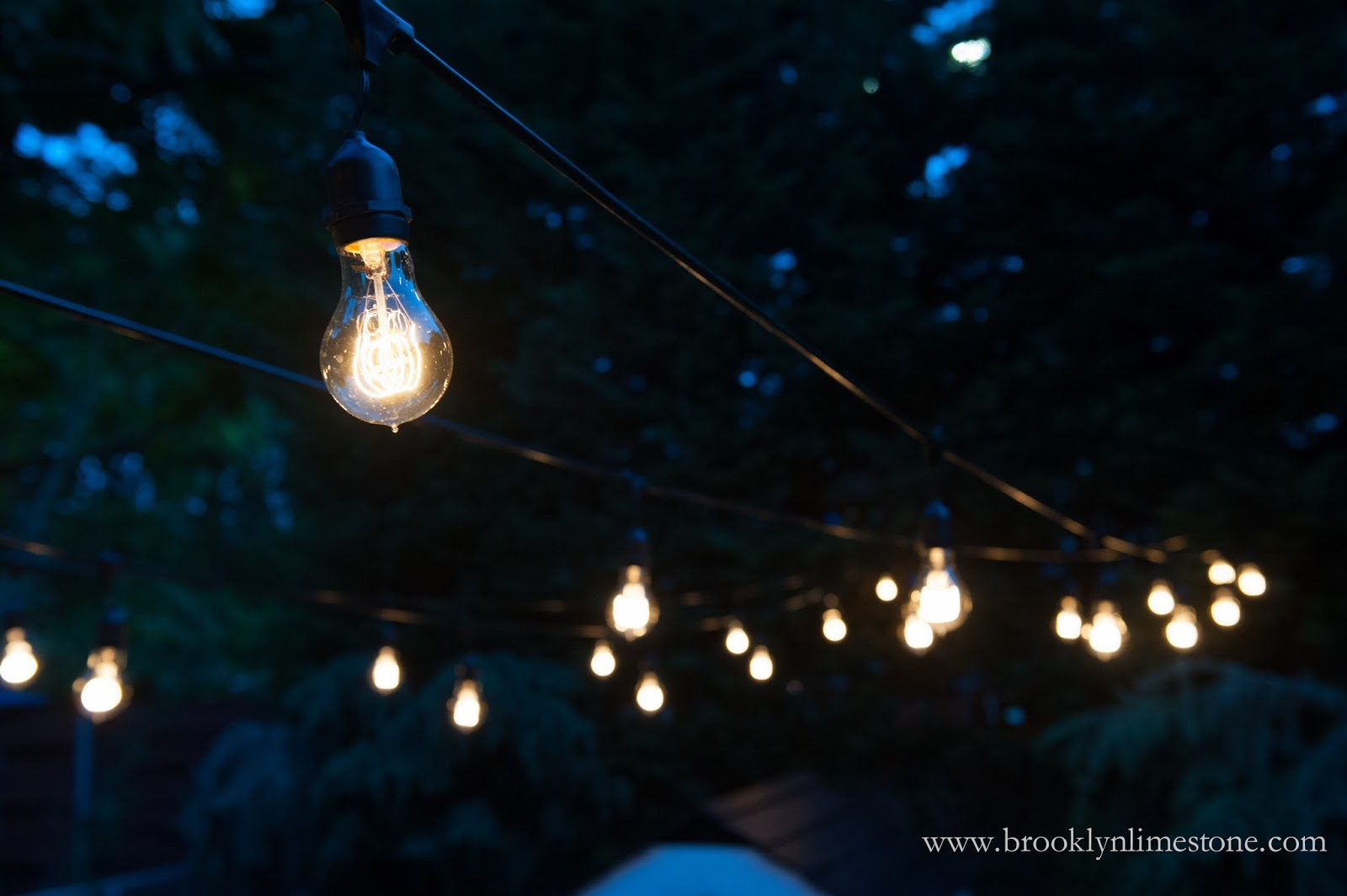 outdoor string lights hung brooklyn limestone