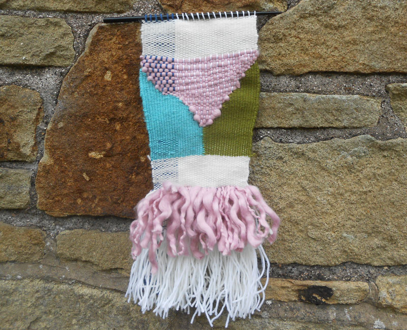 https://www.etsy.com/uk/listing/190868606/handmade-weaving-wall-hanging-white-pink?ref=shop_home_feat_3