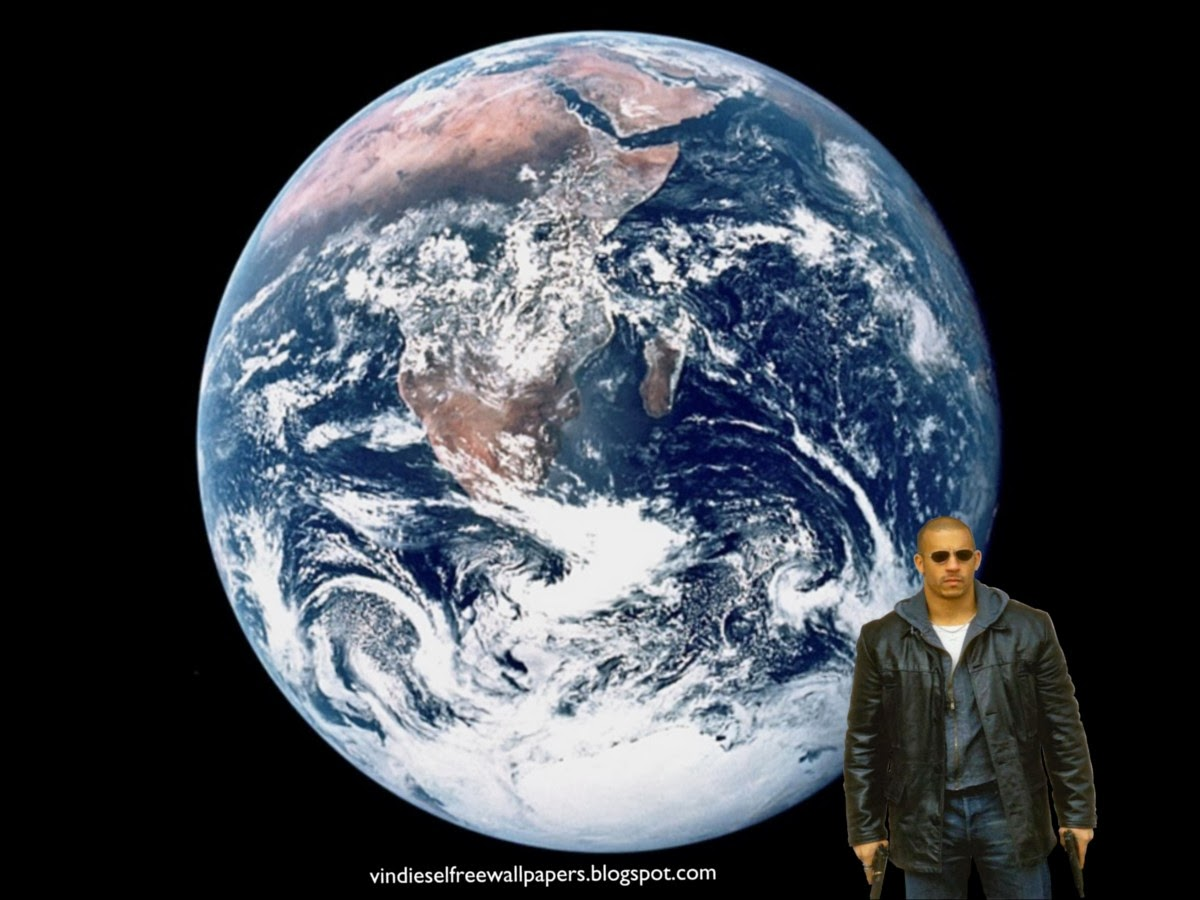 Desktop Wallpaper of Vin Diesel action movie actor with two guns at Planet Earth Seen from Space Desktop Wallpaper