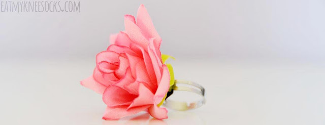 Born Pretty Store sells this 3D floral ring in six colors, with an adjustable silver ring and bright fabric rose.