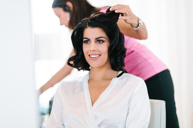 beautiful bride getting her hair done