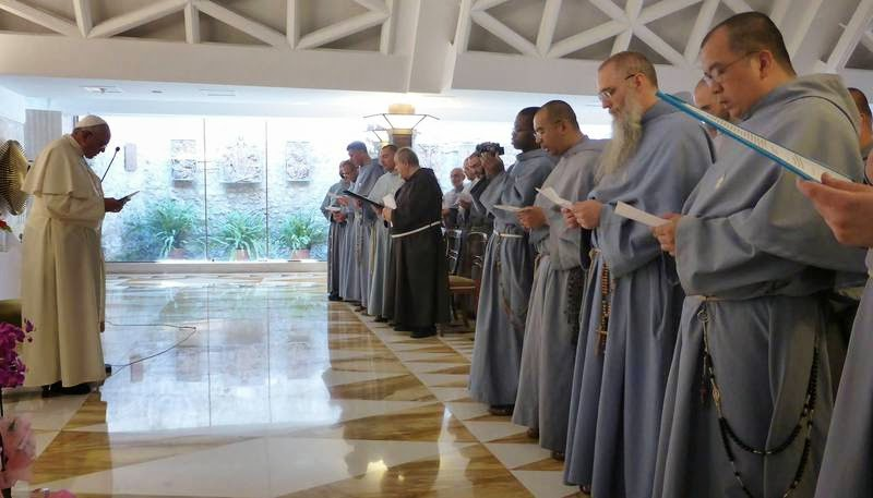 (Franciscan Friars of Immaculate celebrate Novus Ordo Missae with Francis.)