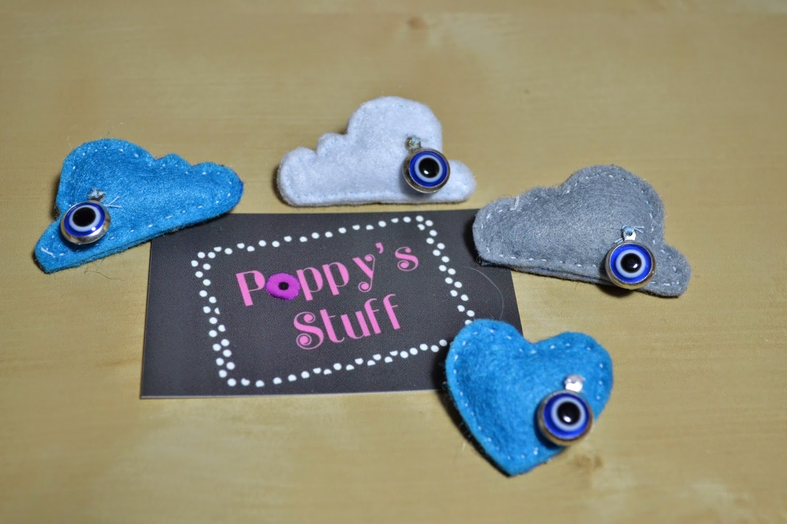 https://www.etsy.com/listing/188682306/felt-brooch-cloud-with-evil-eye-for-baby?ref=shop_home_active_5