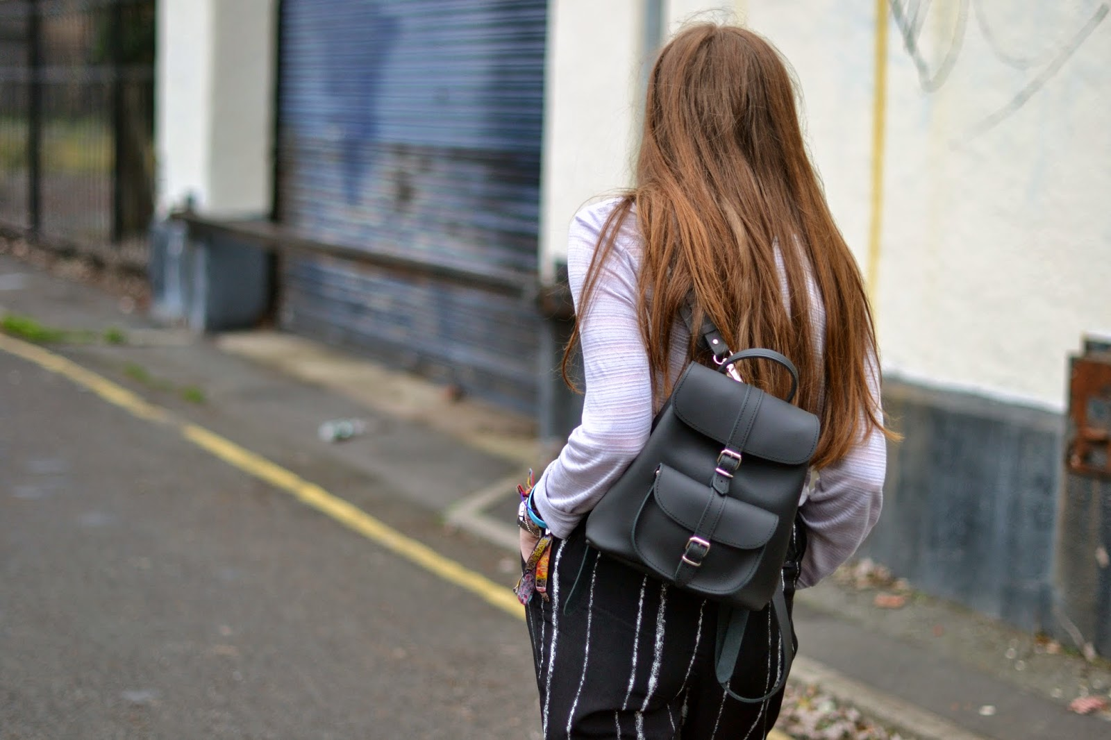 grafea streetstyle shoot with black baby backpack