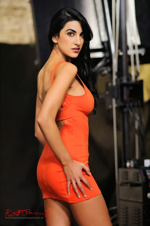 Sensual look, orange body con dress photographed 'studio as location'. Photographed by Kent Johnson.