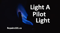 a lit pilot light burning blue flame