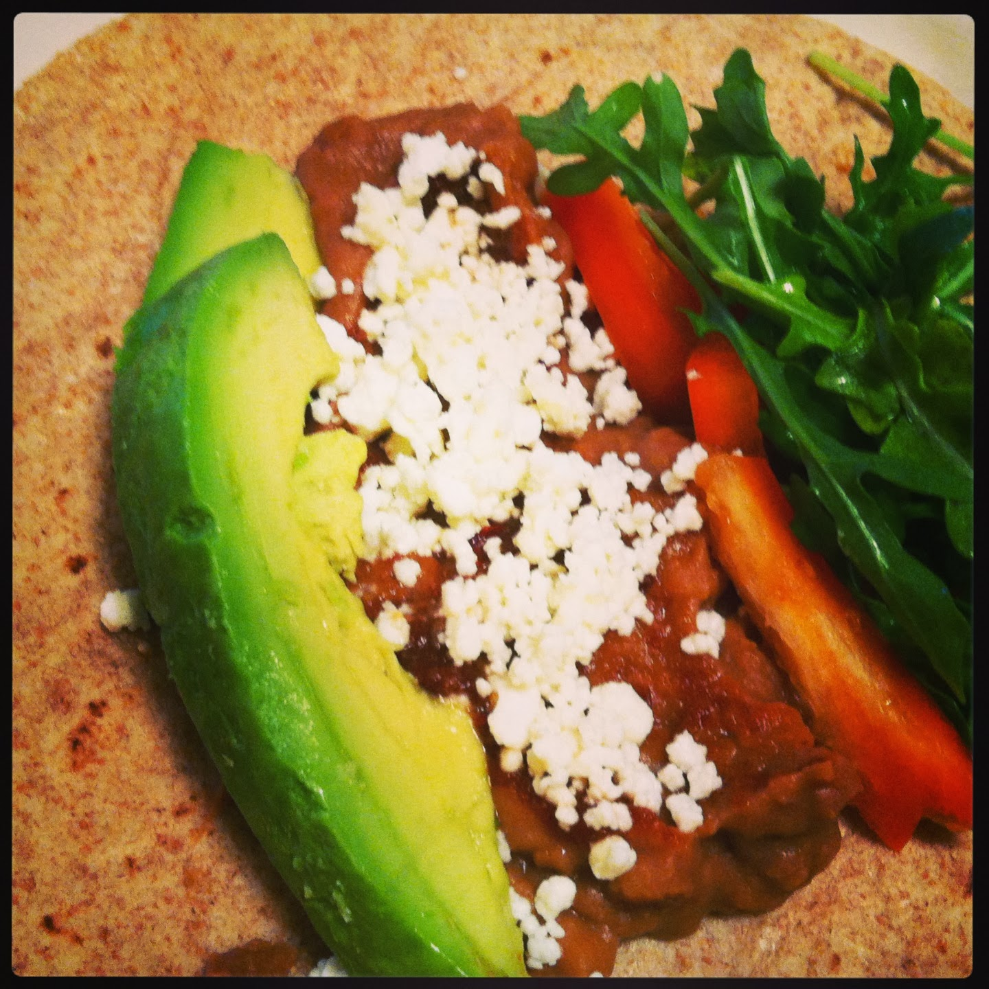 soft tacos with refried beans, avocado and other vegetables