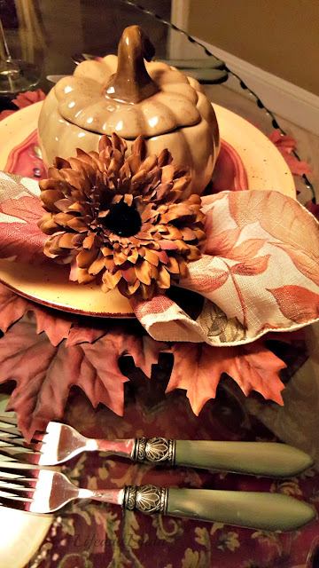 pumpkin soup tureens with leaves placemats