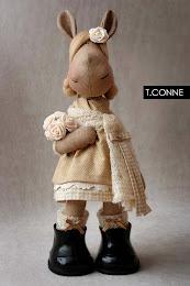 Т.Конне