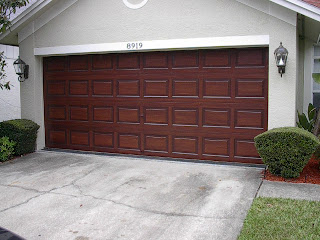 Paint a metal garage door to look like wood everything i for Paint garage door to look like wood