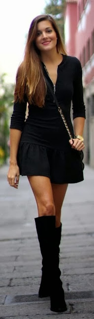 Black bourse with mini skirt and long boots