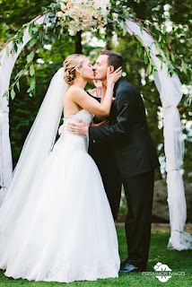 Laura and David kiss at their wedding ceremony