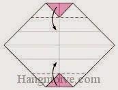 Bước 6: Gấp hai mắt tờ giấy vào trong