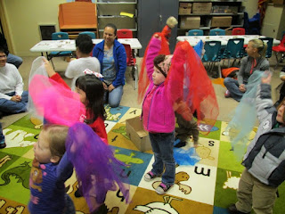 kids playing with scarves at storytime