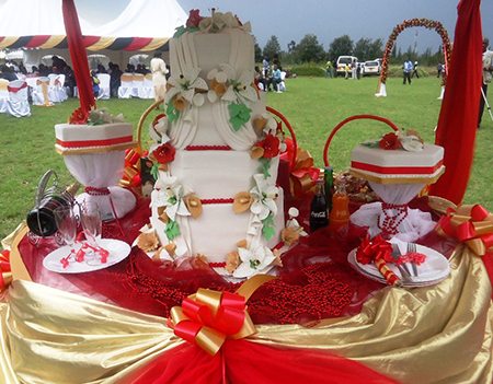 The wedding show must continue yes there is need to it is a cake that is all over the table accompanied by many things because the kenyan wedding cake is too important it needs an entourage and friends junglespirit Choice Image