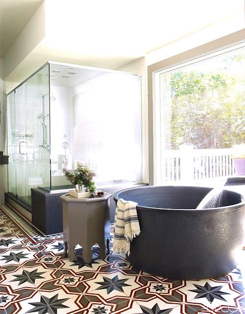 Bobby Flay celebrity bathroom Moroccan cement tile floor modern tub glass shower