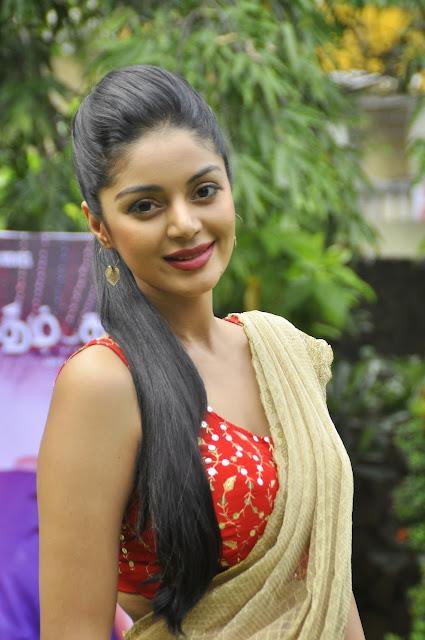 Sanam Shetty looks spicy cute in Red Sleeveless Choli and Saree Beautiful Actress