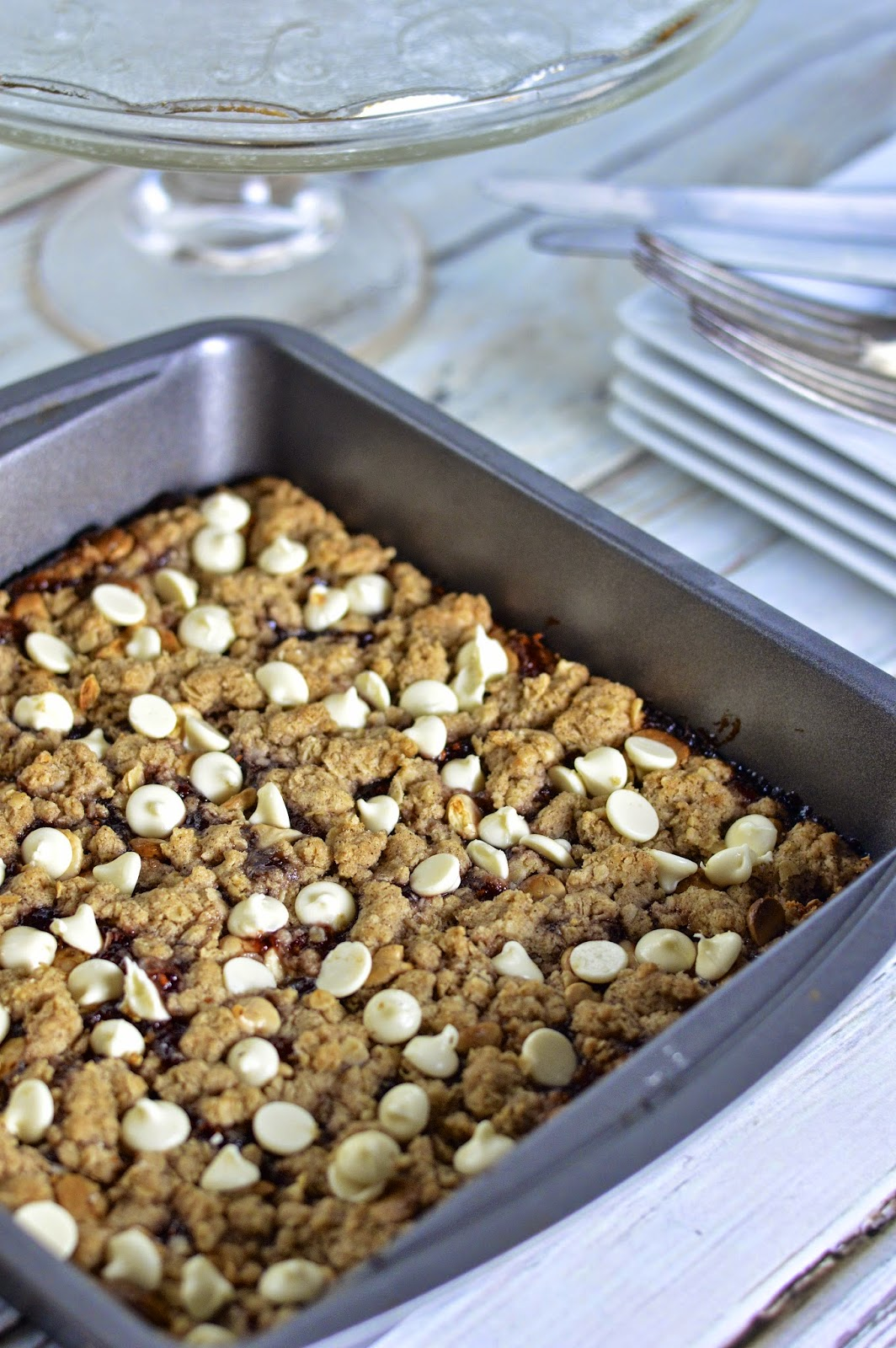 This decadent gluten free dessert is packed with spice, tart fruit and creamy white chocolate chips for the perfect holiday bar.