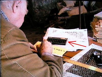 Linus Pauling, is hown using a Hewlett-Packard calculator