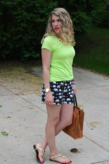 green neon tee, Loft elephant print shorts, gold rope sandals, suede tote, neon necklace