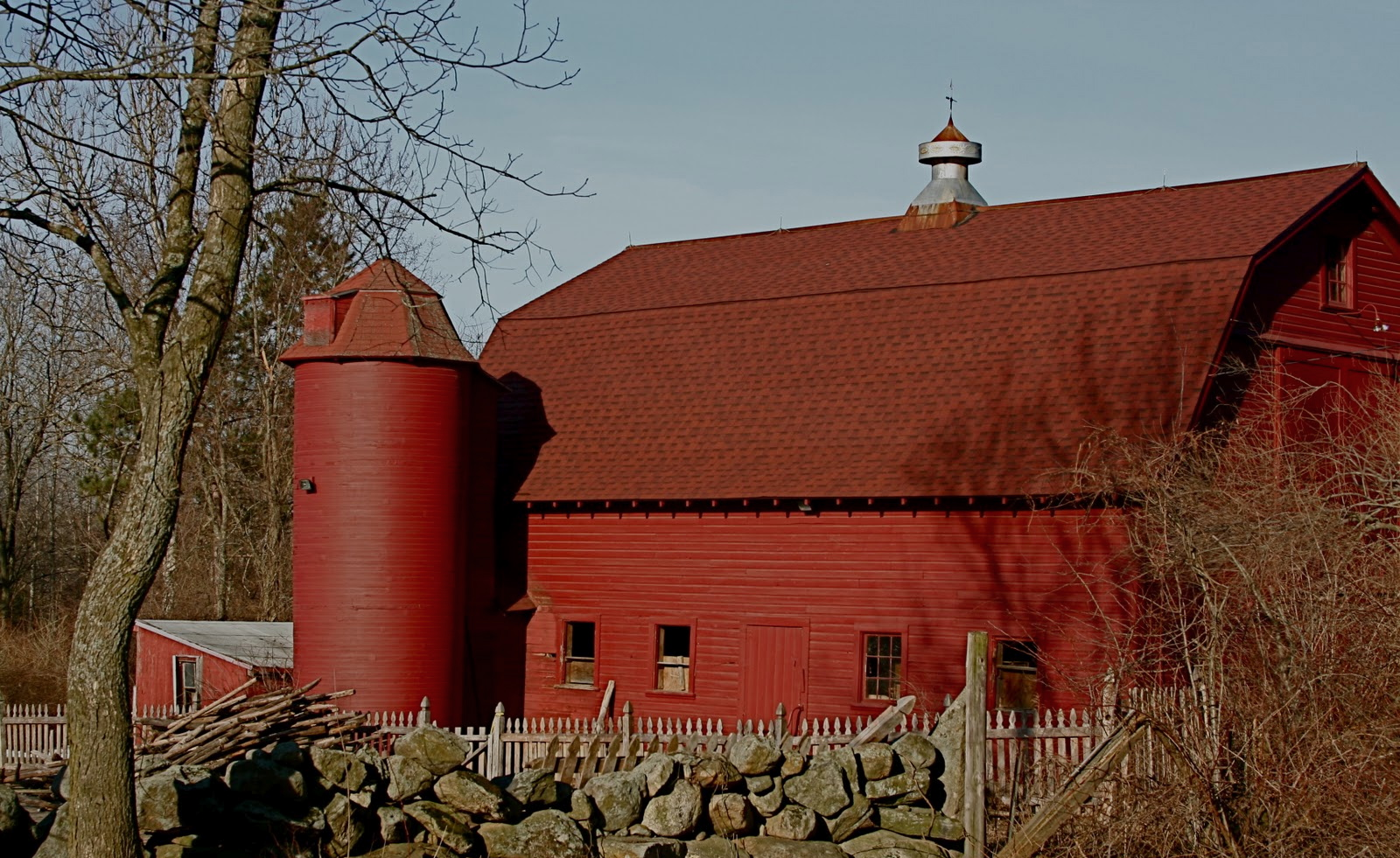 Trucks And Red Barns: Why Are Barns Usually Painted Red?