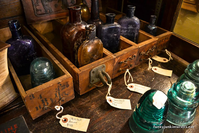 vintage_bottles_and-antique_glass_insulators_during_A_tour_through_Franklin,_Tennessee _via_Funky_Junk_Interiors