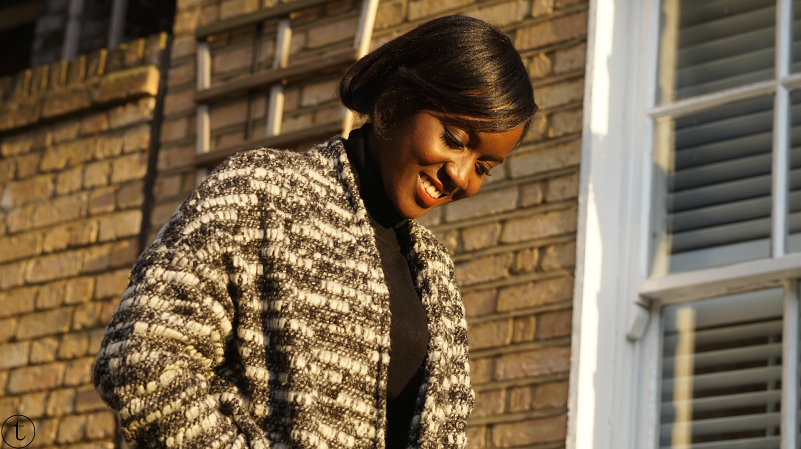outfit post wearing black turtle neck with grey chunky vest