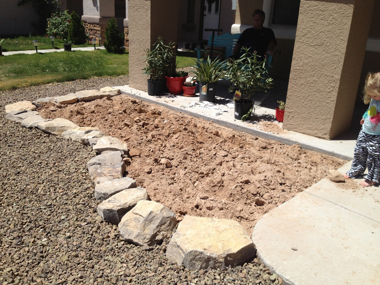 Desert Backyard Makeover : We also cut the extra plastic off and raked the rocks back into place