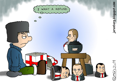 i want a refund russian voters protests elections president vlaimir putin prime minister dmitry medvedev matryoshka doll stool opened gift box boy in sweater boots fur cap