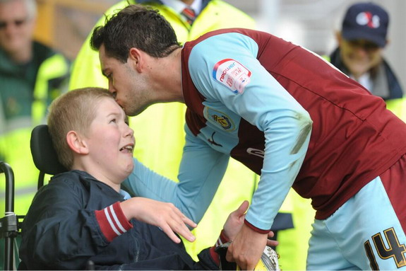 Burnley player give his boots to disabled fan