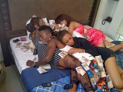 naija boy in bed with three women