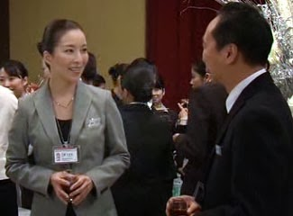 Mikami and Captain Sakurada smile at each other at the reception.