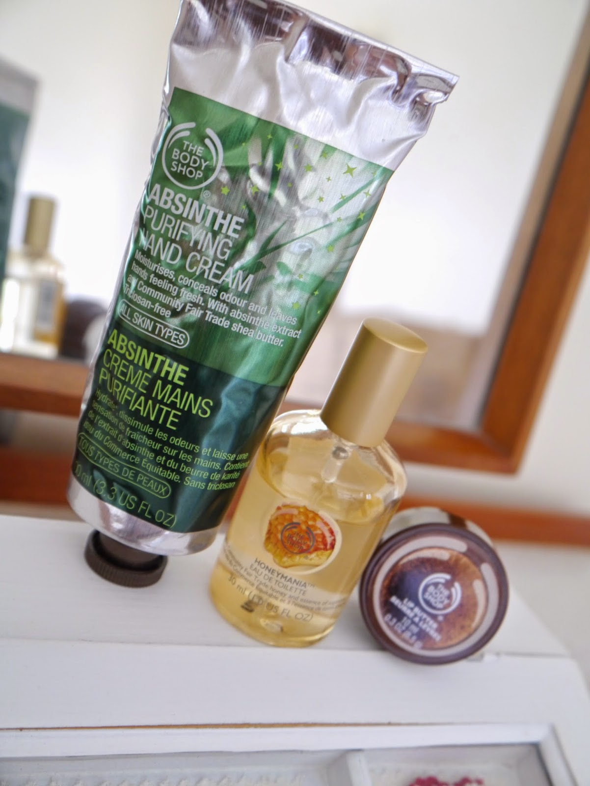 photo of Body Shop Honeymani Eau de Toilette, Body Shop Absinthe Purifying Hand Cream, Body Shop coconut lip butter