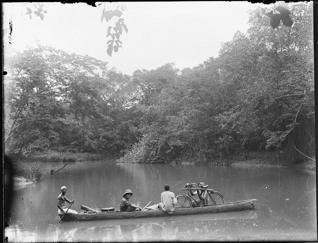River transport by traditional 'dugout' canoe. Gold Coast. 1919. E.O. Teale photograph collection.