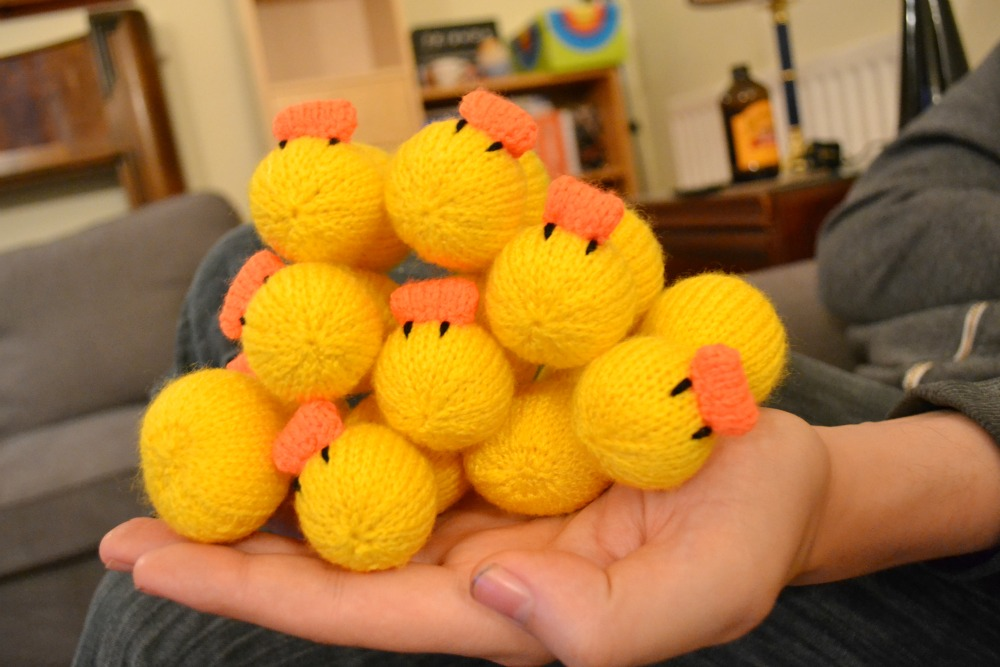 knitted yellow ducks beaks