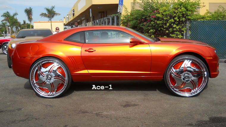 "Candy Orange Chevy Camaro on 30"" Dub Revolution Floaters"